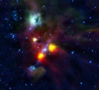 Gaura in spatiu: NGC 1999 este norul verde din partea de sus a imaginii. Pata neagra din dreapta a fost considerata initial un nor dens de praf si gaz, pana in momentul cand Herschel l-a putut investiga. Acum oamenii de stiinta cred ca este de fapt o gaura neagra.