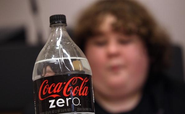 Un copil intr-o clasa de nutritie pentru adolescenti obezi in Aurora, Colorado.
