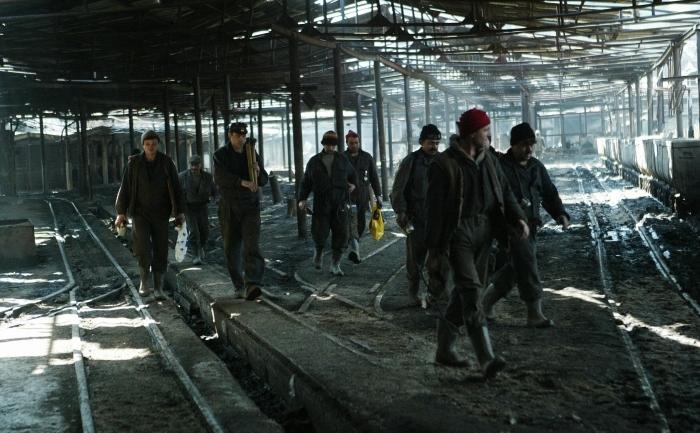 Mineri ieşind din tură.