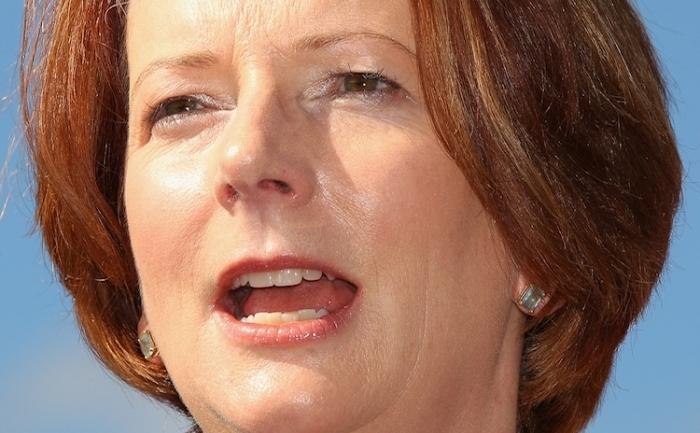 Prim-ministrul australian Julia Gillard vorbeşte la o conferinţă de presă pe 4 aprilie, în Sydney, Australia.