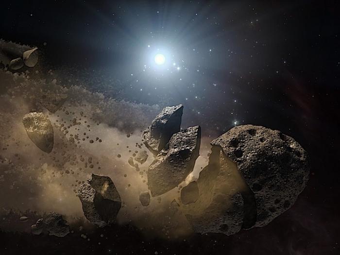 Imagine artistică a unui asteroid spart în bucăţi