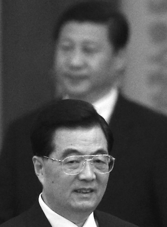 Head of the CCP Hu Jintao (Front) and his presumed successor Xi Jinping (Back) are pictured on Sept. 29, 2012 in the Great Hall of the People in Beijing, China. Xi has appeared to be a reluctant successor, attempting at the end of August and the beginning of September to withdraw from his expected elevation at the 18th Party Congress in November.