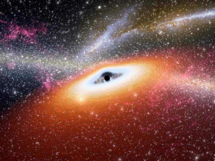 Imagine artistică despre o gaură neagră masivă (punctul negru) din centrul unei stele tinere