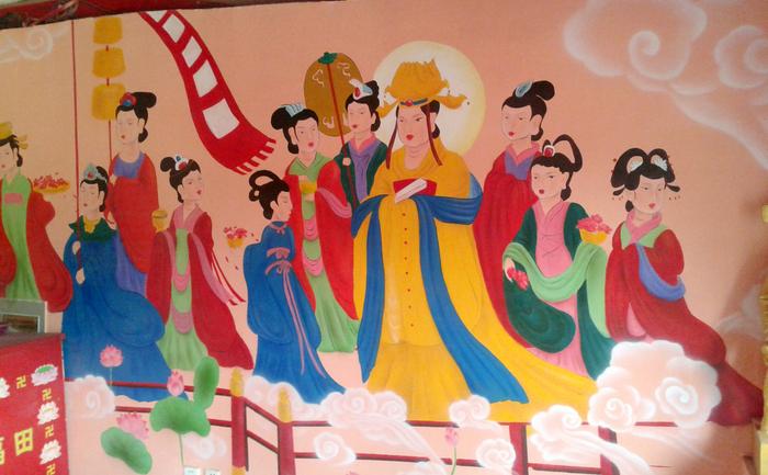 """Această poză făcută pe 14 oct 2013 înfăţişează fresca actuală de la Templul Yunjie din Chaoyang, provincia Liaoning. Autorităţile chineze au """"restaurat"""" frescele antice budiste pictând deasupra imagini din benzi desenate cu mituri taoiste, atrăgând indignare online."""