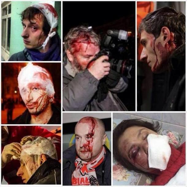 Jurnalişti bătuţi de poliţia ucraineană după 1 decembrie 2014.
