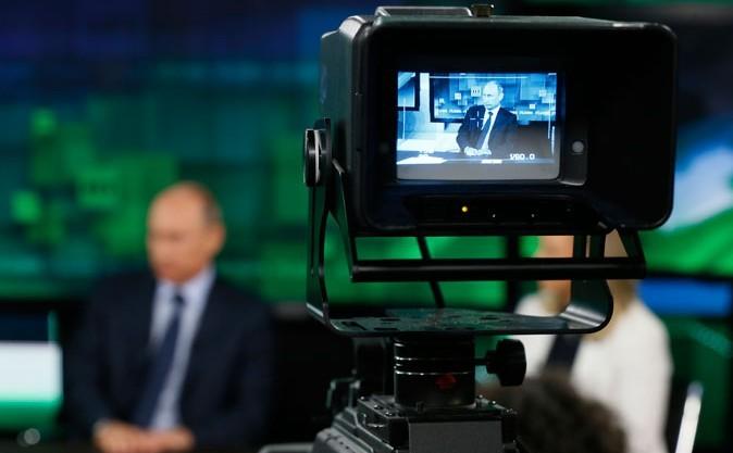 Vladimir Putin la sediul televiziunii de stat Russia Today, 11 iunie 2014 în Moscova
