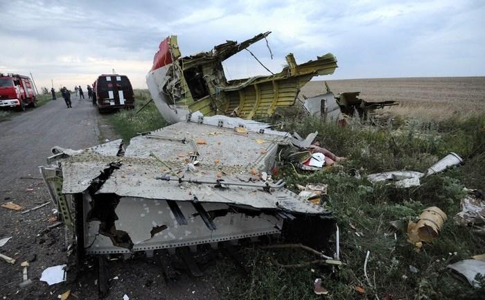 Rămăşiţele cursei Malaesia Airlines, MH17, doborâtă pe 17.07.2014 deasupra Ucrainei de o rachetă. Toate cele 295 persoane aflate a bord au fost ucise.