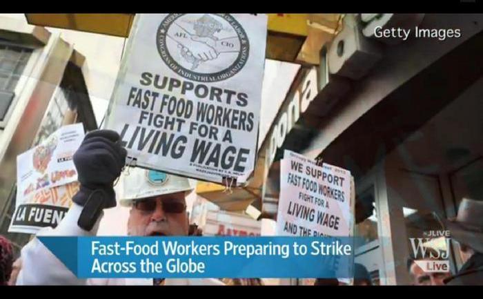 Manifestaţii ale angajaţilor din fast-food-uri în celebra piaţă newyorkeză Times Square.