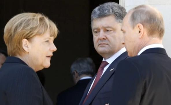 Angela Merkel, Vladimir Putin şi Petro Poroşenko s-au întâlnit în Franţa pe fondul crizei din Ucraina.