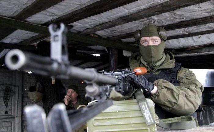 Luptători separatişti la un punct de control din Doneţk, 23 ianuarie 2015.