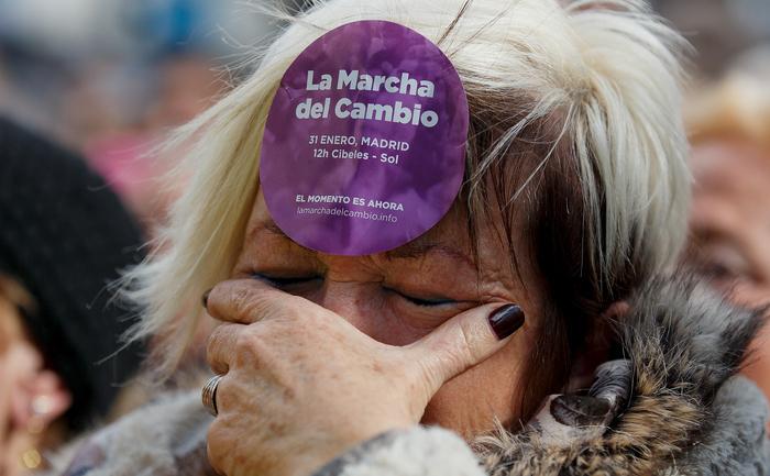 Suporter al partidului Podemos, la o demonstraţie din Mardid, 31 ianuarie