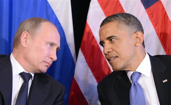 [Arhivă] Preşedintele rus Vladimir Putin (st) şi omologul său american Barack Obama.