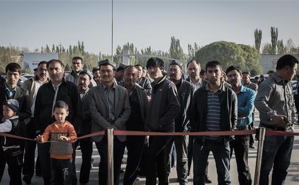 Grup de uiguri în regiunea chineză Xinjiang, 15 aprilie 2015.