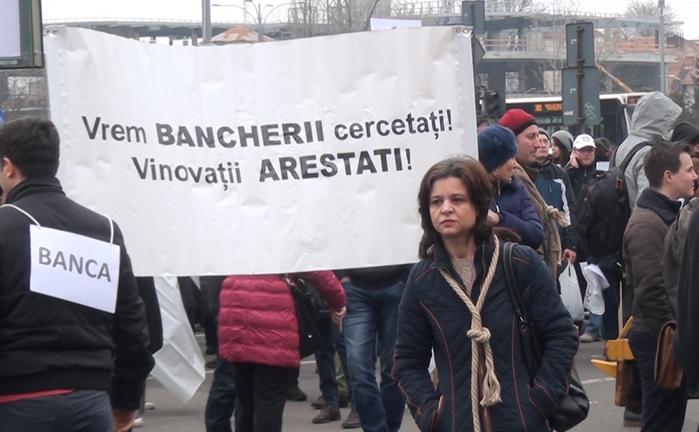 Marş de protest pentru susţinerea Legii dării în plată