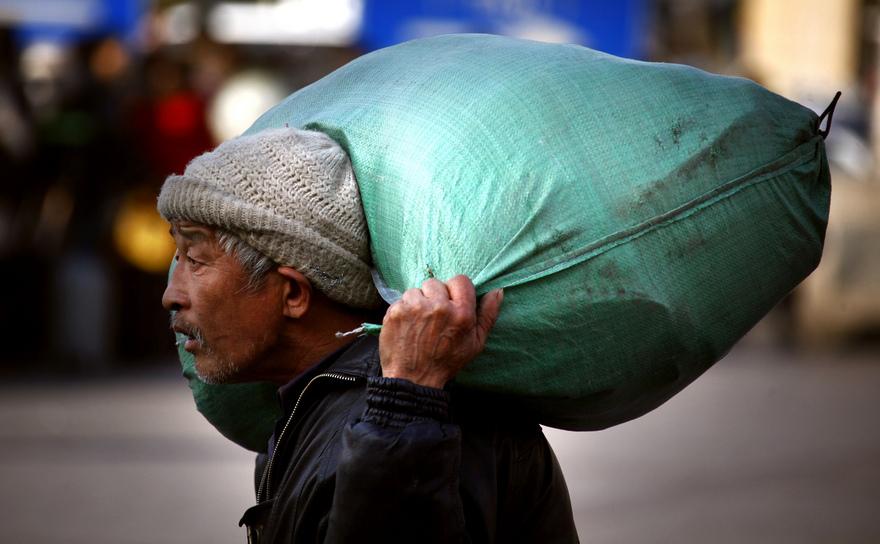 Muncitor chinez migrator în Beijing.
