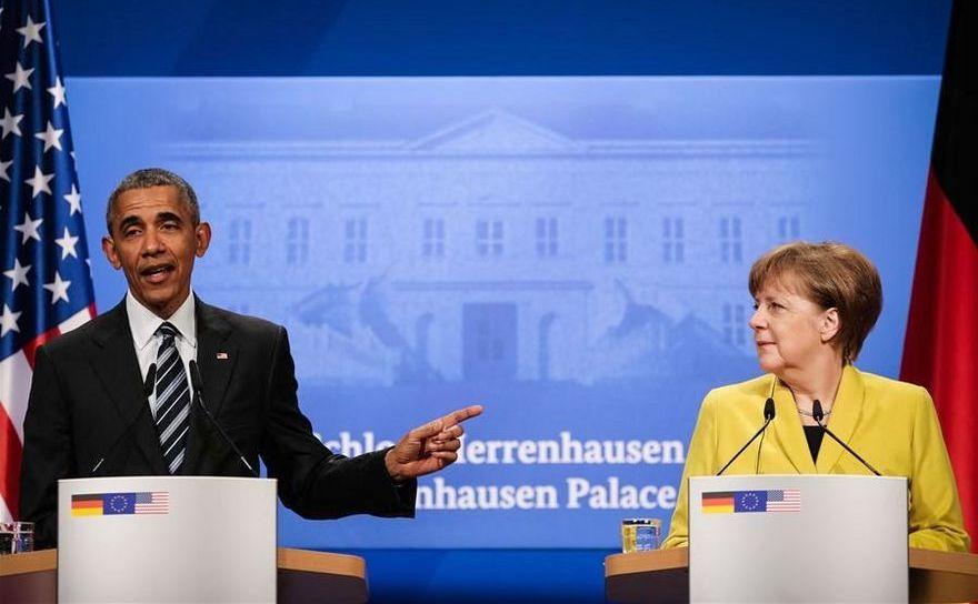 Preşedintele american Barack Obama (st) şi cancelarul german Angela Merkel participă la o conferinţă de presă comună în oraşul german Hanovra, 24 aprilie 2016.