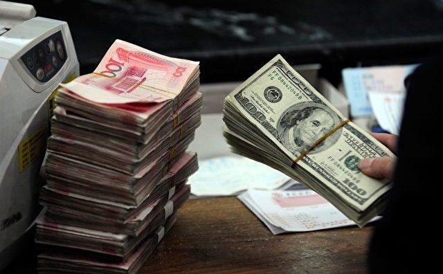 """""""Funcţionarii goi"""" devin responsabili pentru o bună parte din capital scurs în străinătate din China."""
