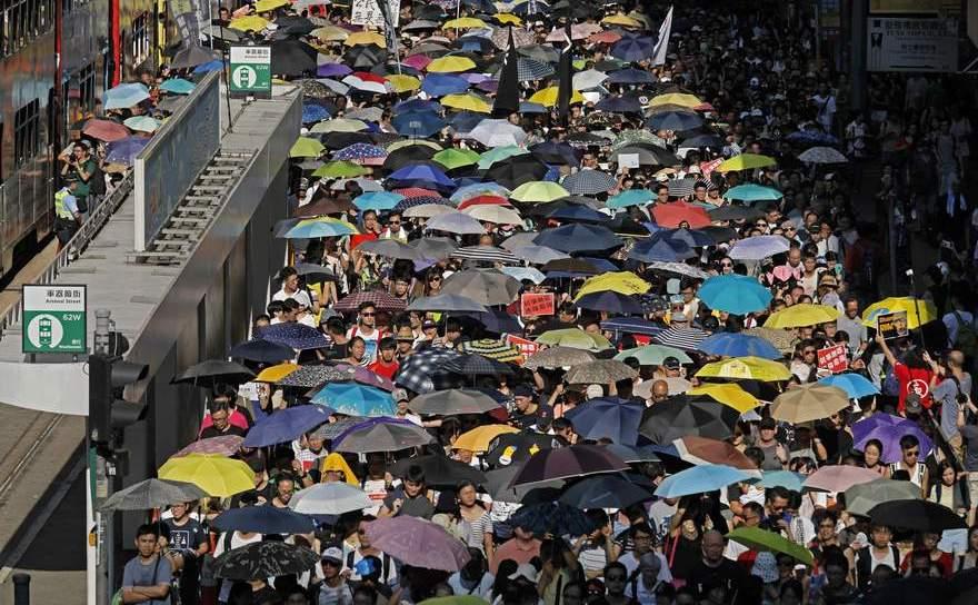Protest împotriva întemniţării a trei activişti pro-democraţie din Hong  Kong de către guvernul local, 21 august 2017.