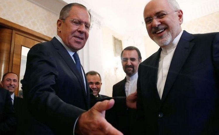 Ministrul rus de externe Serghei Lavrov (st) şi omologul său iranian Mohammad Javad Zarif în timpul întâlnirii lor din capitala rusă Moscova, 14 mai 2018.