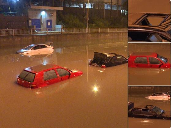 Străzile inundate ale orasului Toronto la ora 1:43 noaptea - pe masură ce apa începe să scadă, se pot vedea 3 vehicule ieşind de sub apă la podul de la Wilson Ave, lângă Keele St.