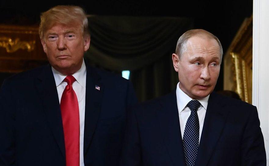 Preşedintele american Donald Trump (st) şi omologul său rus Vladimir Putin
