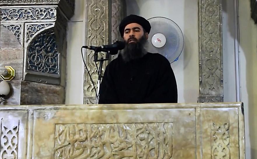 Abu Bakr al-Baghdadi într-un material video publicat în 2014