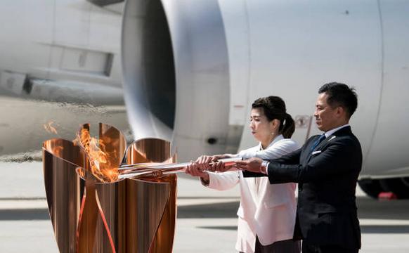 Flacăra olimpică a sosit vineri în Japonia.