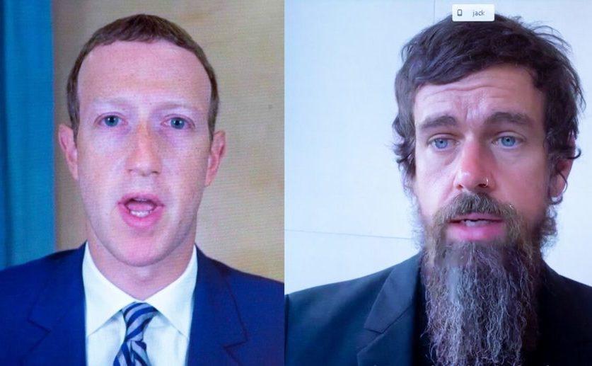 CEO-ul Facebook - Mark Zuckerberg, împreună cu cel al companiei Twitter  - Jack Dorsey